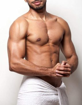Latino man with white towel