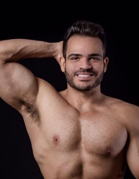 Muscle latino man with smile