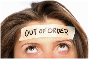 An image of a woman with an out of order sticker on her head