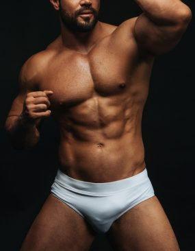tanned man with white trunks